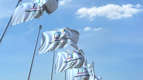 Multiple waving flags with 2018 PyeongChang Winter Olympics logo. 4K editorial Footage