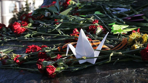 Closeup Flowers on Monument Dead Heroes on Victory Day Footage