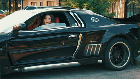 Slow Motion Pretty Girl Sit In A Sports Car And Flirting Footage