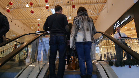 Camera Moves up on Escalator and Shows Shopping Mall Hall Footage
