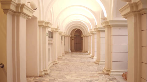 Lit passageway and columns Footage