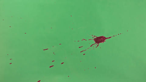 Red Ink Splatter Over Green Screen Background Footage