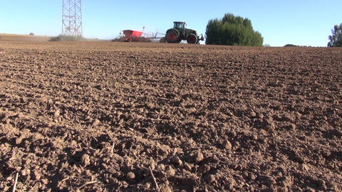 tractor on autumn farm field seeding grains Footage