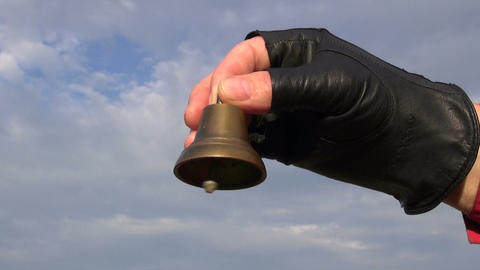 brass bell in hand and beautiful sound Footage