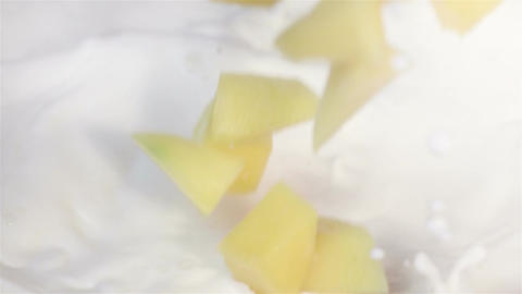 Video of mango falling into milk in real slow motion Footage