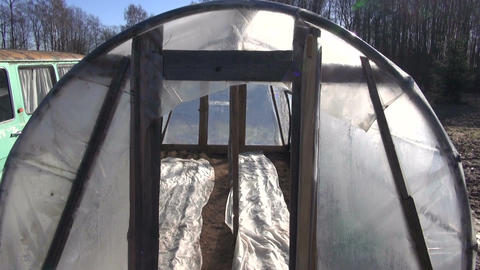 primitive greenhouse hothouse in spring after vegetable seeding Live Action