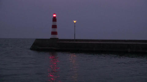 sea lighthouse and pier at night Footage