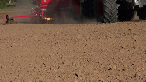 modern tractor seeding crop grain on farm field soil 영상물