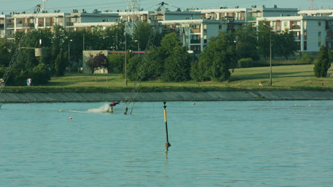 Young Man Waterskiing on the Lake Image