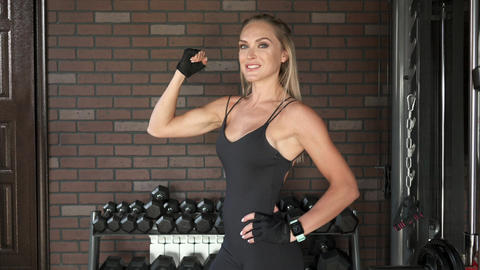 Fitness model posing in the gym Footage