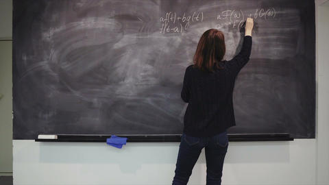 Woman is writing formulas on the desk Footage