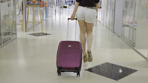 Woman is dragging a suitcase Footage