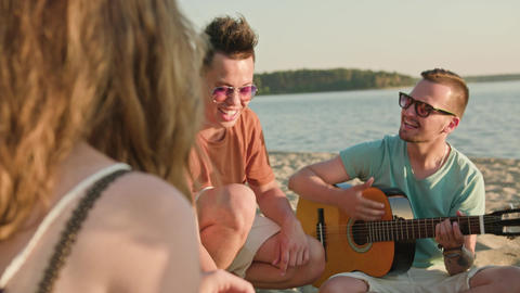 Young People Having Fun on the Beach Image