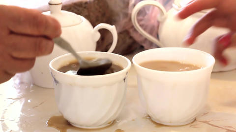 Pouring coffee with a spoon from a cup Footage