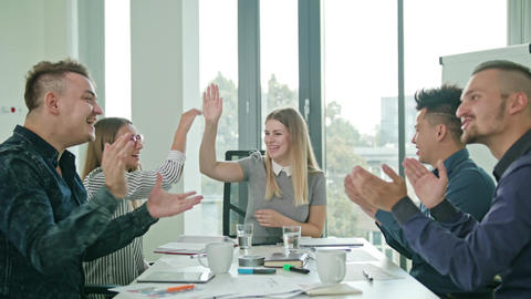 High Fives Members at a Startup in a Modern Office Live Action