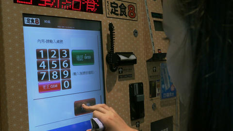 Young girl using Japanese style Automated food ordering machine- ビデオ