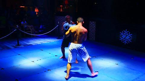 Sportsmen Fight in Thai Box Competition on Floor in Nightclub Footage