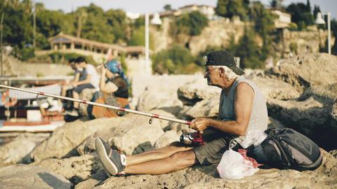 Antalya, Turkey - August 18, 2017: Fisherman on Old Marina Footage