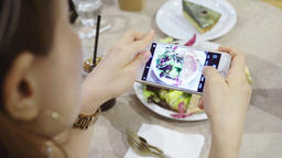 closeup hand holding phone shooting food photograph Footage