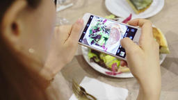 closeup hand holding phone shooting food photograph Live Action