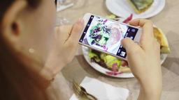 closeup hand holding phone shooting food photograph Footage