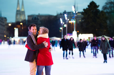 Beautiful senior couple ice skating in city centre. Winter Fotografía