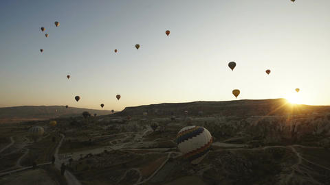 Colorful hot air balloons flying over Red valley at Cappadocia on sunset Live Action