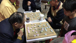 Banqi Chinese board game being played in street at night Ximen Taipei City Footage