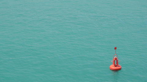 Red buoy floating in sea water Footage