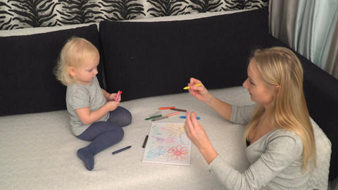 mother and her small daughter are drawing Footage