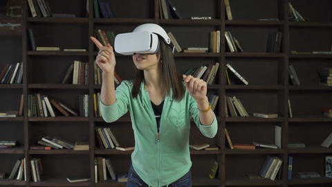 woman in vr headset flipping a virtual screen Footage