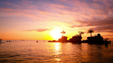 People on vacation, enjoying sunset at tropics. Boracay island. Philippines Footage