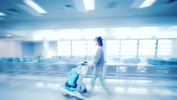 Abstract blurred video of traveling woman in airport terminal Footage