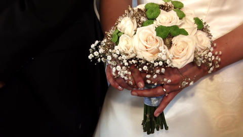 Bouquet of roses on which bride keeps in hand to religious service in which it p Footage