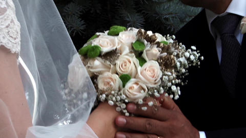 Bride and groom holding a bouquet of roses 42 Footage