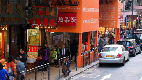 Moving through modern city crowded street. Hong Kong Footage
