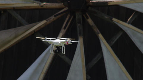 Drone on the camcorder flying in the forest besides some wind mills 34 Footage
