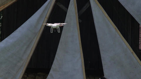 Drone on the camcorder flying in the forest besides some wind mills 34a Footage