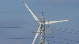 Slow motion seamless loop close up shot white wind turbine blue sky clouds clean Footage