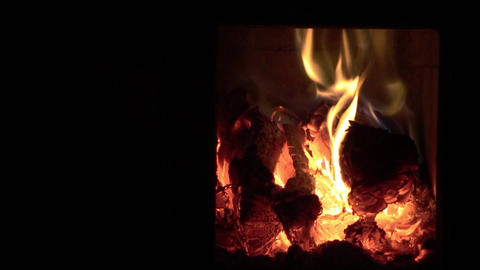 Fire Burning In The Tiled Stove From Kitchen 58 stock footage