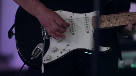 Guitarist fingers on the guitar during a concert 34v Footage