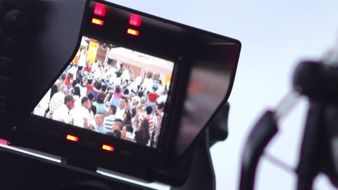 Image seen on the motor control of a professional camera, during a local festiva Footage