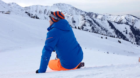 Young man sitting at snow in Ski resort Footage