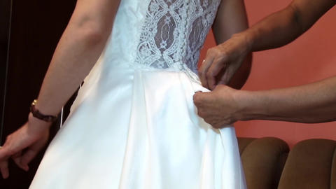 Mother helps bride to dress their wedding dress 14 Footage
