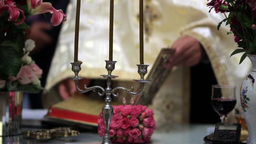 Priest open holy book to read from it during the religious ceremony 61 Footage