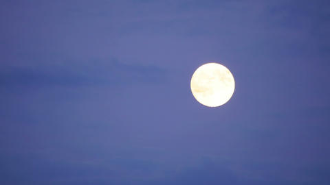 full moon timelapse with clouds at twilight, zoom out, 4k Footage