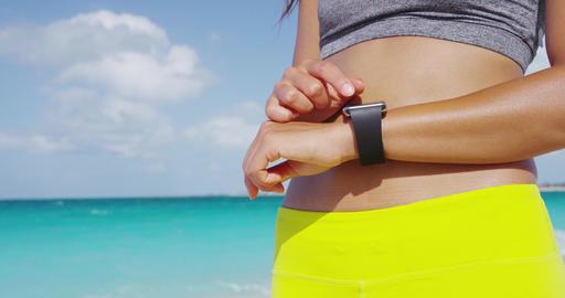 Woman wearing smartwatch touching and swiping screen Footage