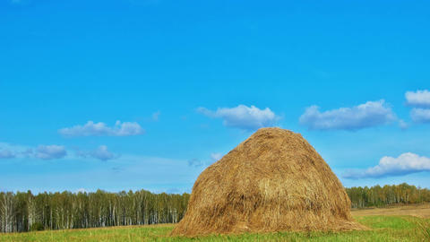 Hay Stack Under Blue Sky Footage