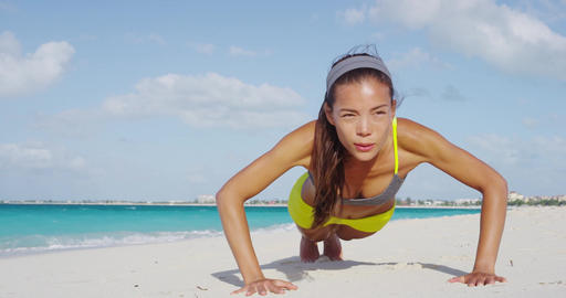 Push ups or press ups exercise by young woman Footage