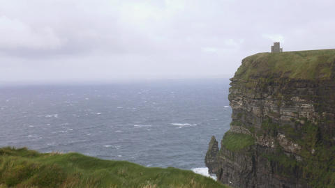 Wind, waves, sea and grass at the Cliffs of Moher, Ireland Live Action